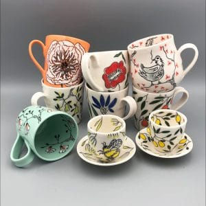 ceramic cups and saucers with deatiled designs