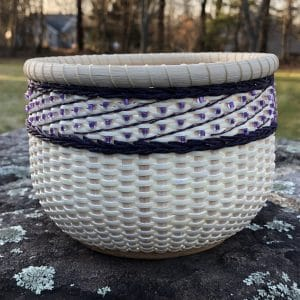 handwoven basket with purple detail