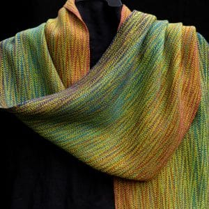 green and orange woven scarf