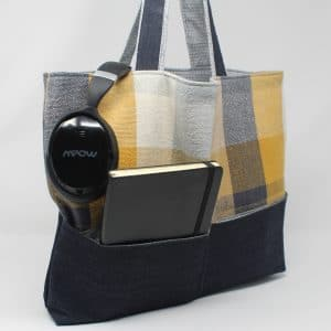 handwoven tote with black leather bottom and gray and yellow sides